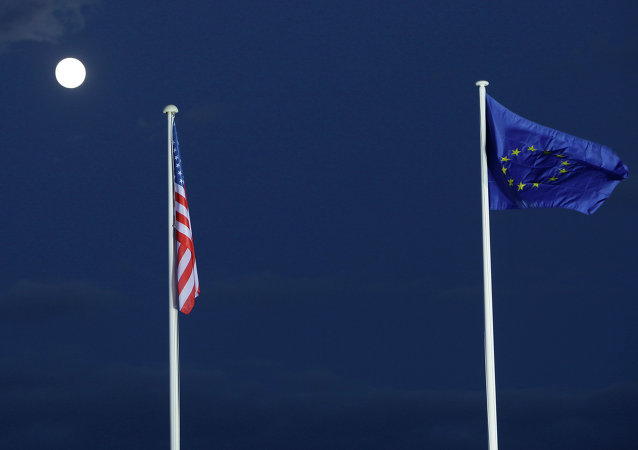 EU and US flags seen beneath the moon outside the EU-US summi