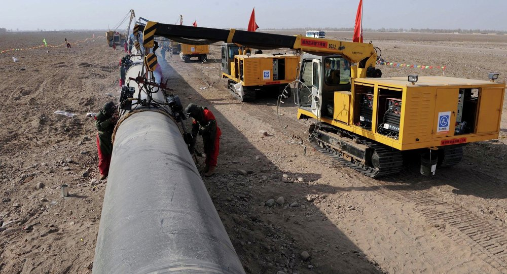 In this photo released by China's Xinhua News Agency, workers weld pipes at the construction site of the second project of west-to-east natural gas transmission pipeline in Fengle Town of Wuwei City, northwest China's Gansu Province, on Monday, March 10, 2008