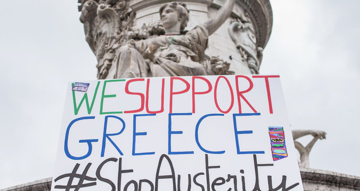 A man holds up a sign reading We support Greece #StopAusterity at the Republique Square during a demonstration against austerity in support of the Greek population in Paris, France, Saturday, June 20, 2015.