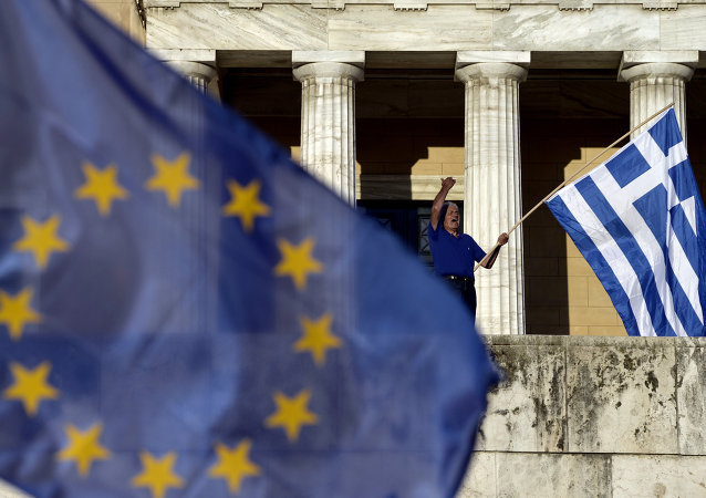 A protester shouts slogans during a pro-European demonstration in front of the Greek parliament in Athens on June 22, 2015.