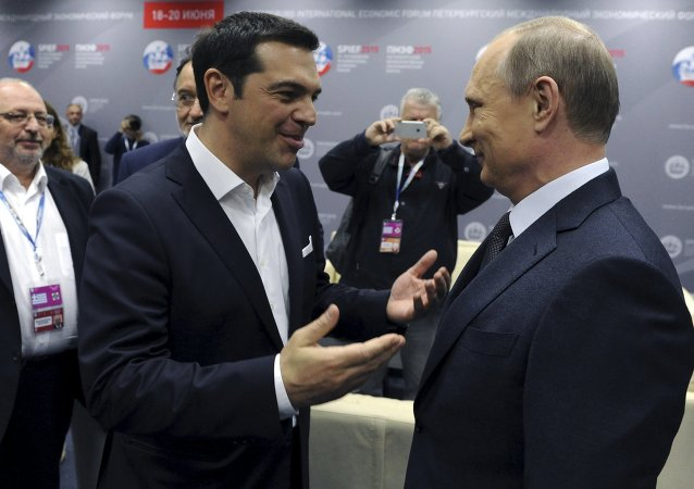 Greek Prime Minister Alexis Tsipras (L) speaks with Russian President Vladimir Putin during a session of the St. Petersburg International Economic Forum 2015 (SPIEF 2015) in St. Petersburg, Russia, June 19, 2015