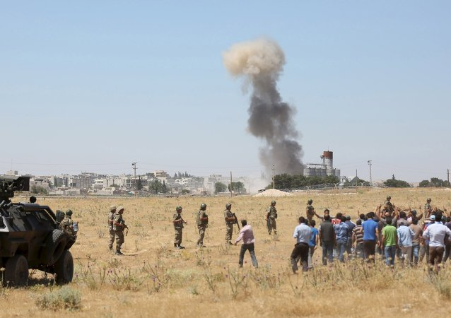 Smoke rises in the Syrian town of Kobani as seen from the Turkish border town of Suruc in Sanliurfa province, Turkey, June 25, 2015