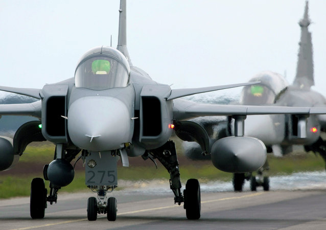 Saab JAS 39 Gripen (Griffin) fighter aircraft taxi out for start during the NATO exercise Loyal Arrow outside Lulea in northern Sweden (file)