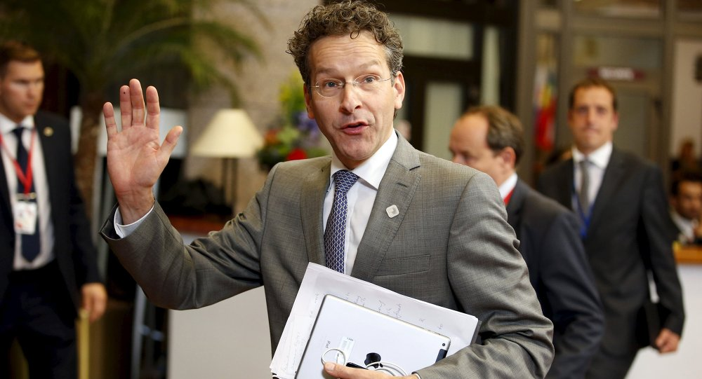 Eurogroup President Jeroen Dijsselbloem leaves the European Commission after a meeting ahead of a Eurozone emergency summit on Greece in Brussels, Belgium June 22, 2015