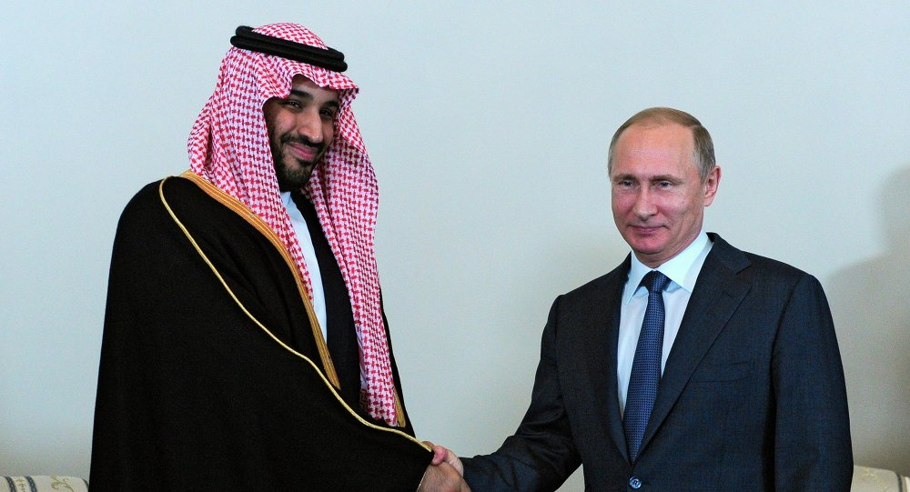 Russian President Vladimir Putin shakes hands with Saudi Arabia's Defense Minister Prince Mohammed Bin Salman in the Konstantin Palace outside St. Petersburg, Russia