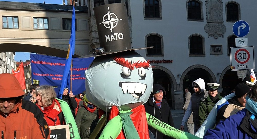 Participants of a rally against NATO's policy by Munich's Rathaus (Town Hall)