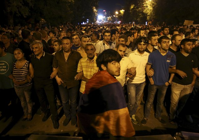 Protesters gather during a rally against a hike in electricity prices in Yerevan, Armenia, June 28, 2015.