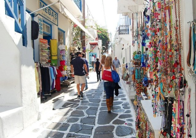 Tourists walking in the streets of Mykonos town, Greece.