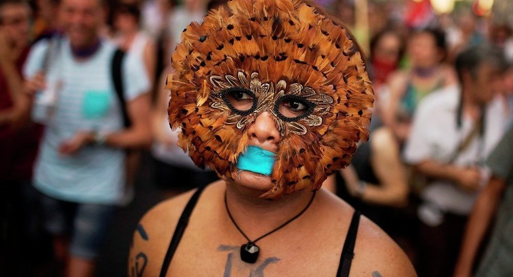 A protester takes part in a march against the Public Security Law gag law in Madrid, Spain, Tuesday, June 30, 2015.