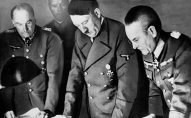 Adolf Hitler, center, confers with Field Marshal General Walther Von Brauchitsch, left, commander-in-chief of the Germany Army; and Colonel-General Franz Halder, Chief of the German Army staff, in Berlin on Aug. 7, 1941
