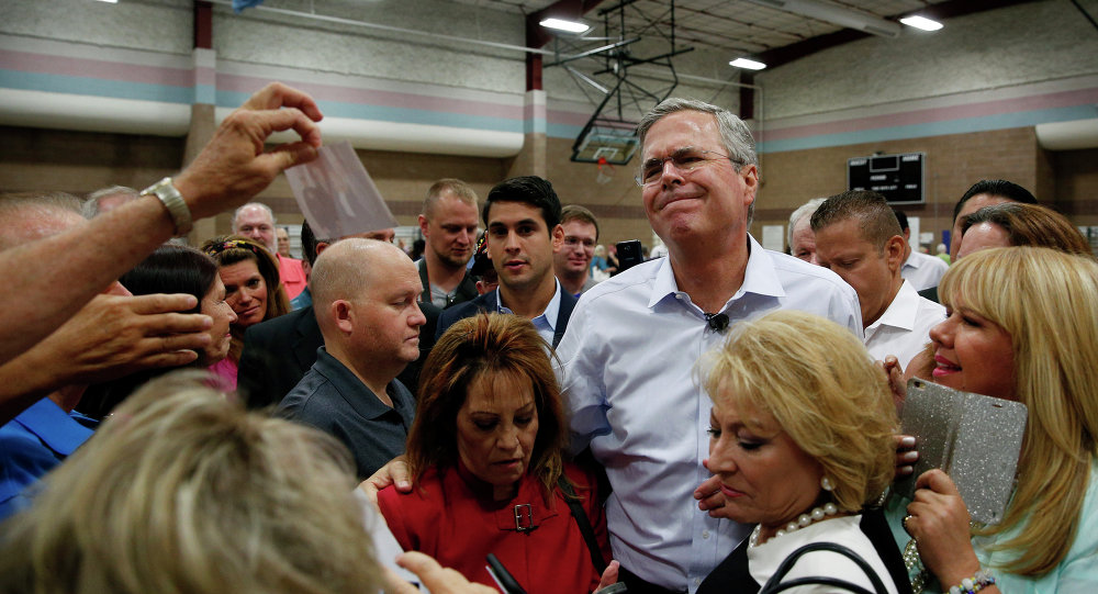 Republican presidential candidate, former Florida Gov. Jeb Bush reacts while meeting people after speaking at a campaign event Saturday, June 27, 2015, in Henderson, Nev.
