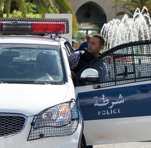 A Tunisian police car patrols in front of the Riu Imperial Marhaba Hotel in Port el Kantaoui, on the outskirts of Sousse south of the capital Tunis, on June 27, 2015