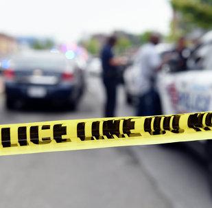 Police officers work behind police tape blocking a street near the Washington Navy Yard in Washington, Thursday, July 2, 2015