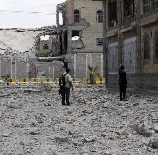 Journalists look at damage at the Yemeni army's main headquarters after it was hit by a Saudi-led air strike in Sanaa, June 7, 2015