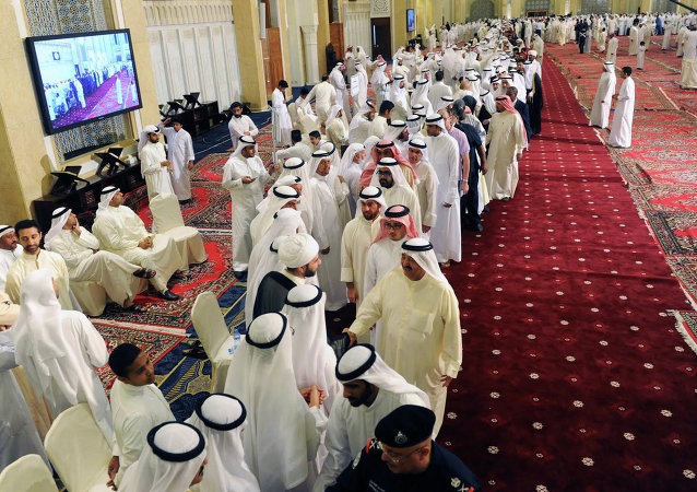 Kuwaitis at the Grand Mosque pay their respects to the families of victims of a terrorist attack on the Shiite Imam Sadiq Mosque in Kuwait City.