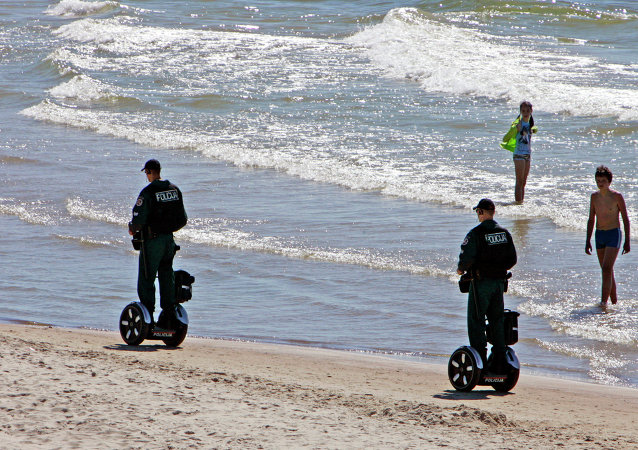 Police officers ride Segway scooters as they patrol the seaside resort of Palanga, Lithuania