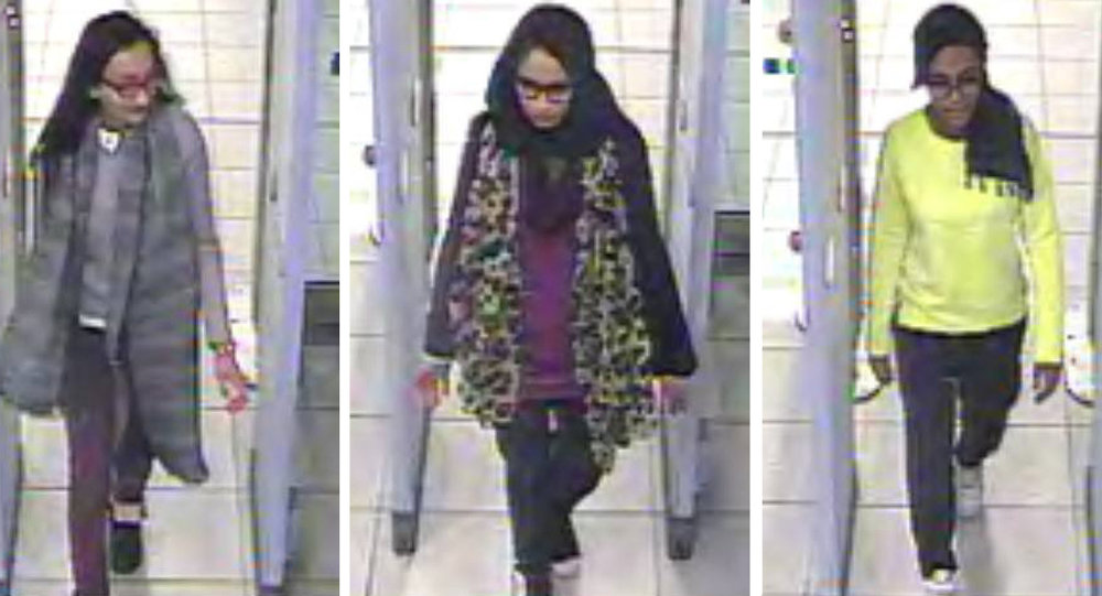 Kadiza Sultana, left, Shamima Begum, centre and and Amira Abase going through security at Gatwick airport, before they caught their flight to Turkey on Tuesday Feb 17, 2015
