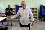 Greece's Finance Minister Yanis Varoufakis casts his vote at a polling station in Athens, Sunday, July 5, 2015