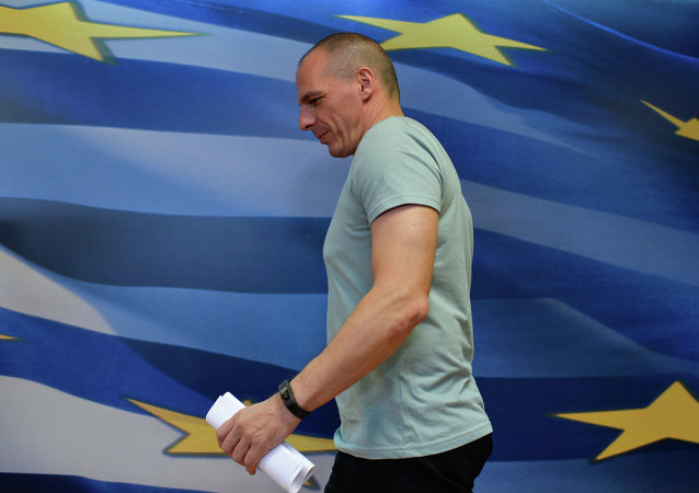 Greek Finance Minister Yanis Varoufakis arrives for his press conference in Athens on July 5, 2015, after early results showed those who rejected further austerity measures in a Greek crucial bailout referendum were poised to win