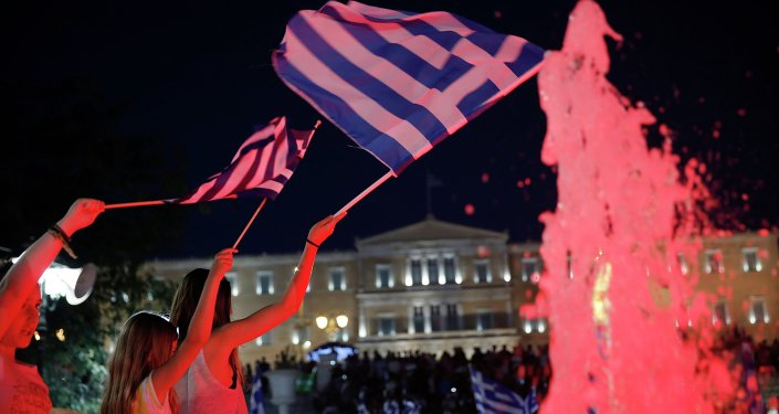Young girls wave Greek flags