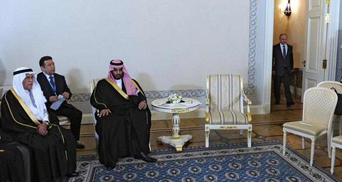 President Vladimir Putin (right) and Mohammad bin Salman Al Saud (second right), the deputy crown prince and defense minister of Saudi Arabia, meeting in St.Petersburg, June 18, 2015