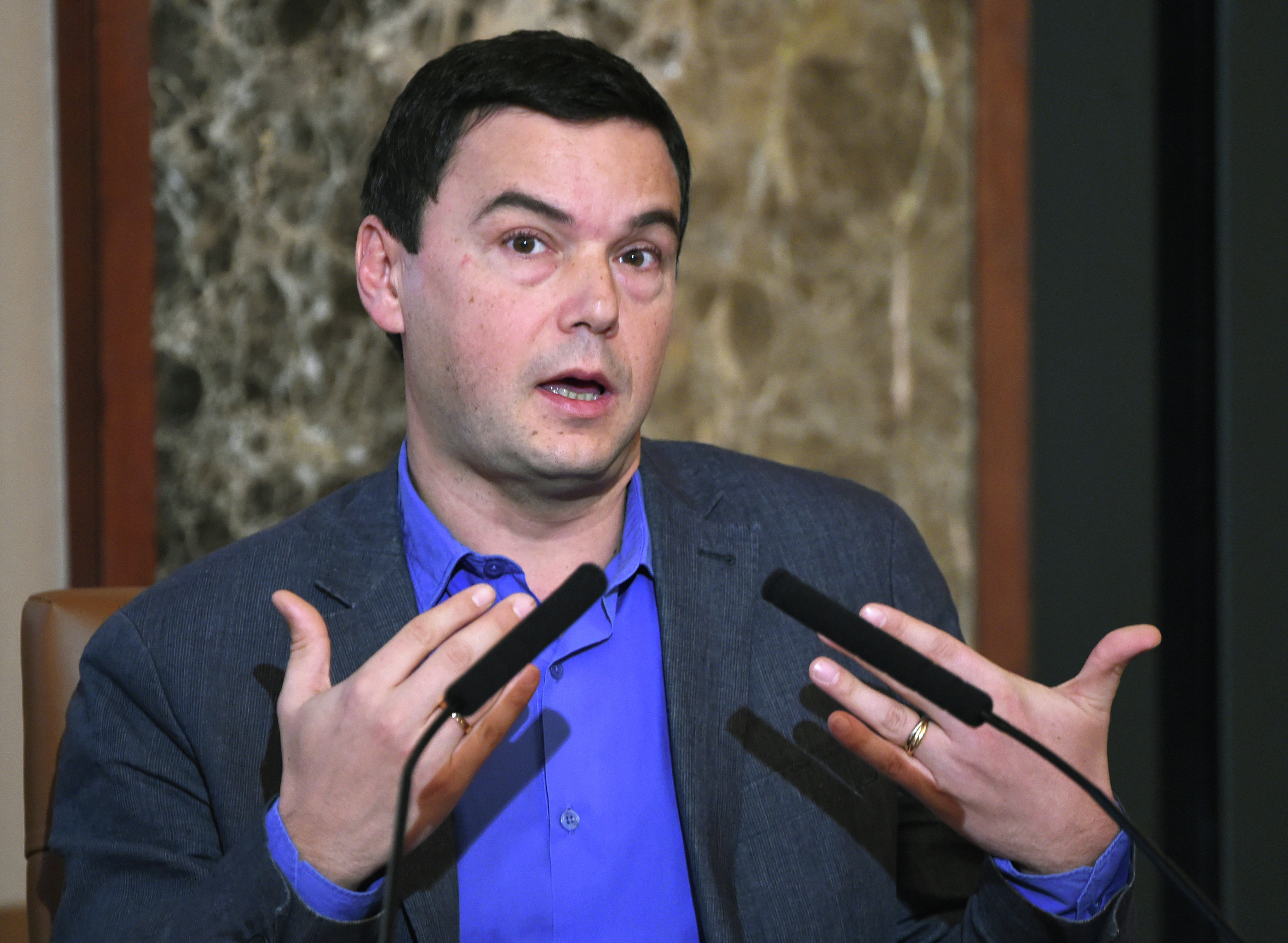 French economist Thomas Piketty answers a question during his press conference at Japan National Press Club in Tokyo on January 31 2015.