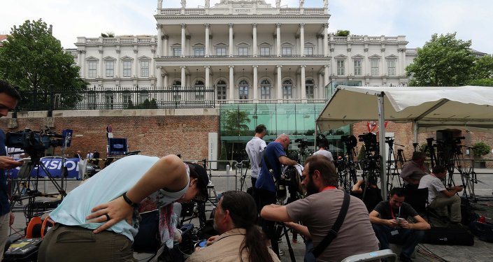 Journalists wait in front of Palais Coburg