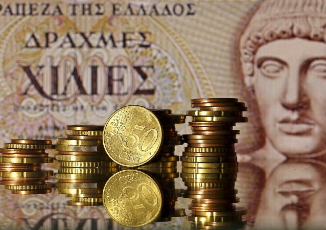 Euro coins are seen in front of a displayed of Head of Apollo on a 1.000 Drachma old Greece banknote in this file photo illustration taken in Zenica, Bosnia and Herzegovina, June 30, 2015