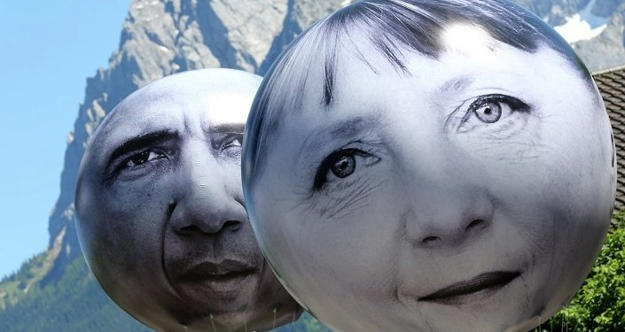 Balloons with the faces of German Chancellor Angela Merkel, left, and U.S. President Barack Obama