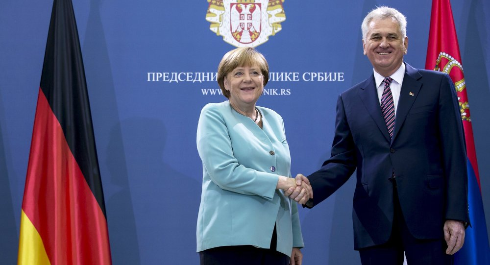 German Chancellor Angela Merkel shakes hands with Serbian President Tomislav Nikolic before their meeting in Belgrade, Serbia July 9, 2015