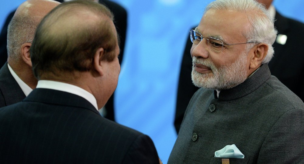 Indian Prime Minister Narendra Modi, right, speaks to Prime Minister of Pakistan Muhammad Nawaz Sharif, back to a camera, during the SCO (Shanghai Cooperation Organization) summit in Ufa, Russia, Friday, July 10, 2015
