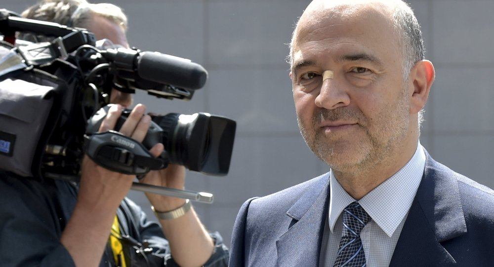 European Economic and Financial Affairs Commissioner Pierre Moscovici arrives to attend an euro zone finance ministers meeting in Brussels, Belgium, July 11, 2015