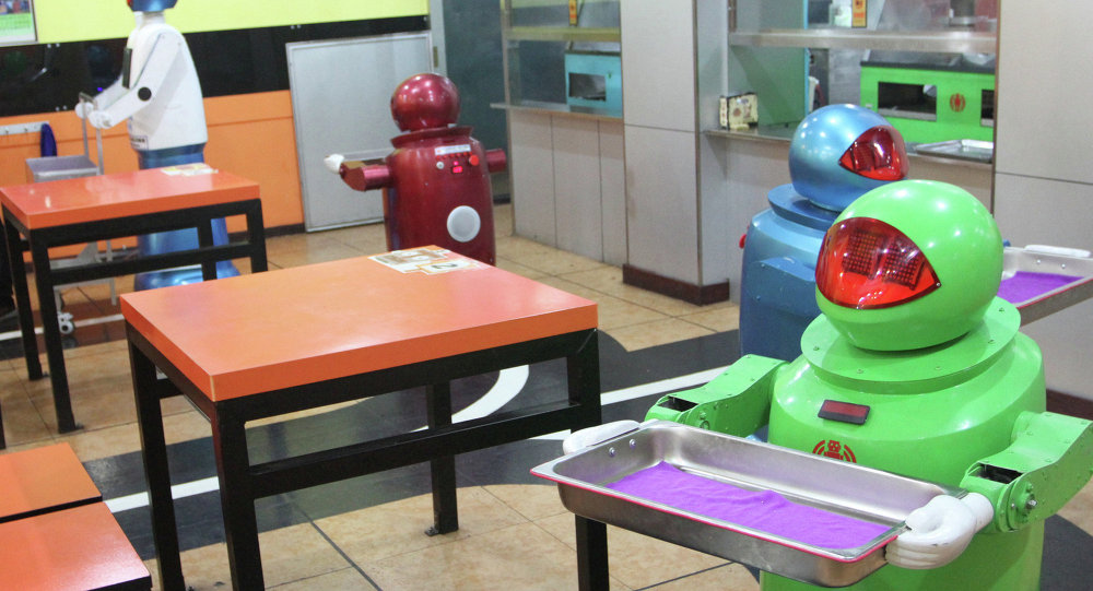 Robots work in a robot-themed restaurant in Harbin, northeast China's Heilongjiang province on January 16, 2013