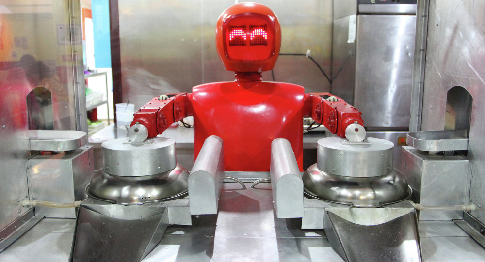 A robot cooks in a robot-themed restaurant in Harbin, northeast China's Heilongjiang province on January 16, 2013