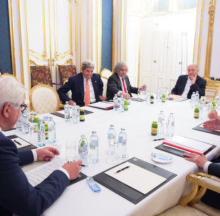 (L-R) German Foreign Minister Frank-Walter Steinmeier, US Secretary of State John Kerry, US Secretary of Energy Ernest Moniz, French Foreign Minister Laurent Fabius, the High Representative of the European Union for Foreign Affairs and Security Policy Federica Mogherini and British Secretary of State for Foreign and Commonwealth Affairs Philip Hammond (C) meet at the Palais Coburg Hotel, where the Iran nuclear talks are being held, in Vienna, Austria on July 14, 2015