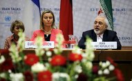Iranian Foreign Minister Mohammad Javad Zarif speaks next to European Union High Representative for Foreign Affairs and Security Policy Federica Mogherini (L) during a plenary session at the United Nations building in Vienna, Austria July 14, 2015