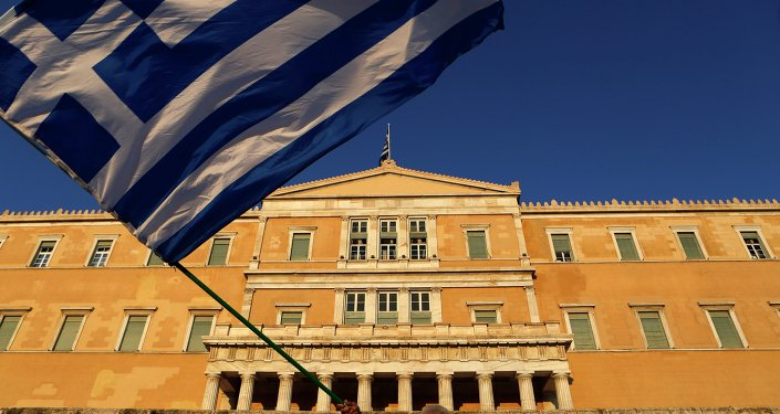 Greek flag in front of the Greek Parliament during a rally at Syntagma square in Athens