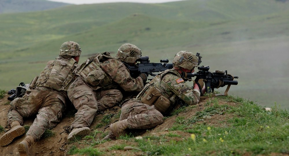 US and Georgian servicemen take part in the joint US-Georgia military exercise at the Vaziani base outside the Georgian capital, Tbilisi, Georgia, Thursday, May 21, 2015