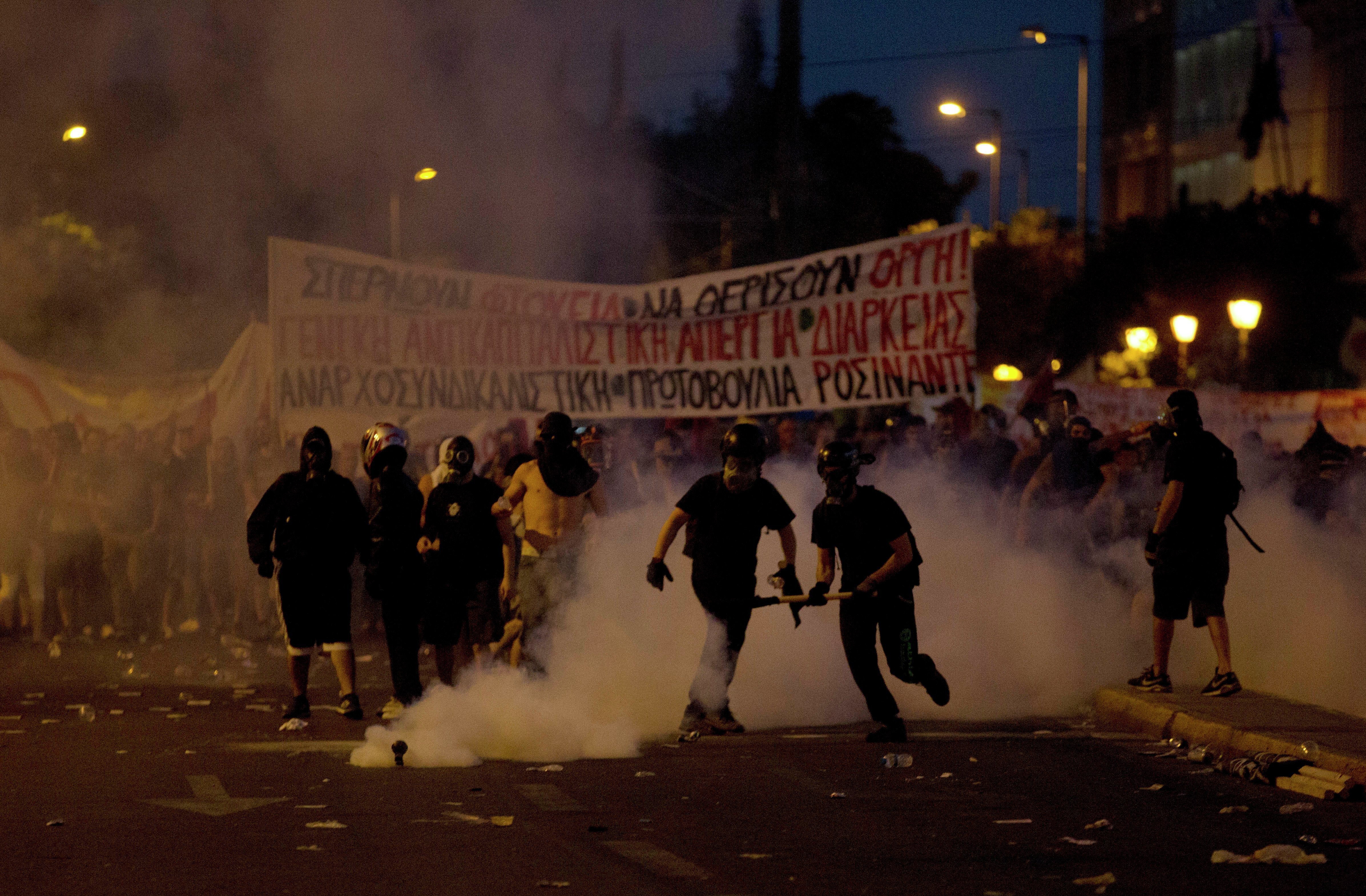 Anti-austerity protesters clash with riot police during a rally in Athens, Wednesday, July 15, 2015