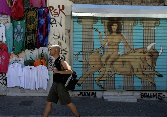 A pedestrian passes a graffiti depicting, the Greek mythological story about the abduction of the Phoenician maiden named Europa by the Olympian god Zeus in the form of a bull, in a symbolic depiction of what some see as the European crisis, at the shutter of a closed shop at Monastiraki tourist district in Athens, Monday, May 25, 2015