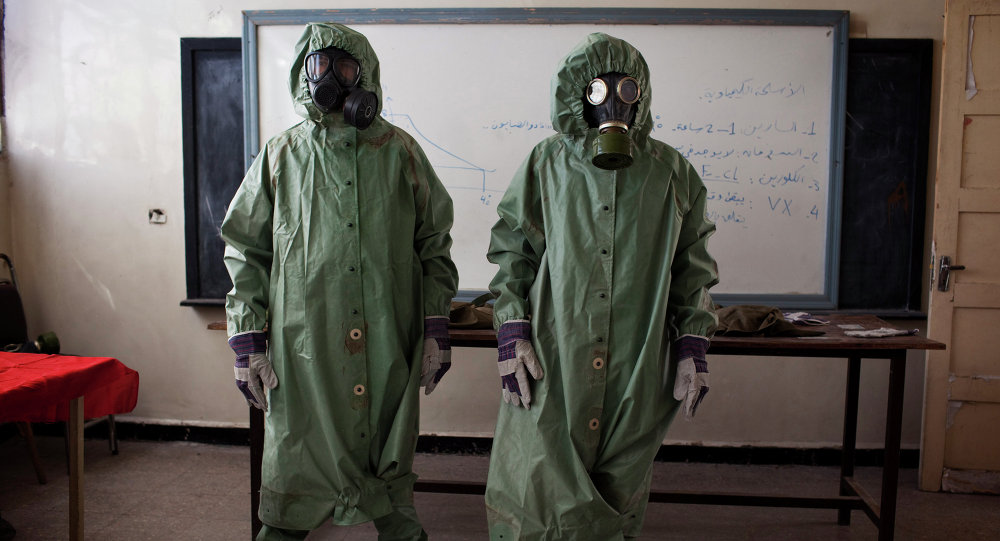 Volunteers wear protective gear during a class of how to respond to a chemical attack, in the northern Syrian city of Aleppo