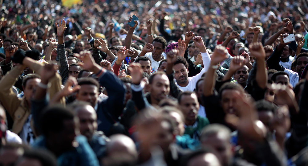 FILE - In this Sunday, Jan. 5, 2014 file photo, African migrants chant slogans during a protest in Rabin's square in Tel Aviv, Israel. Dozens of Africans have accepted an Israeli government offer to relocate to Uganda
