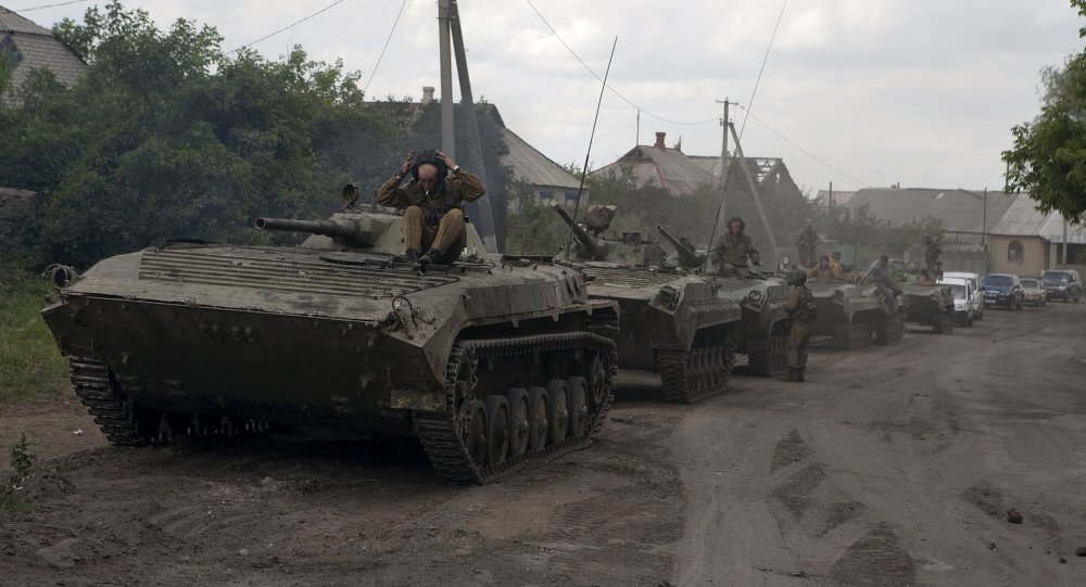 An armored column of the Donetsk People's Republic forces is seen on the roadside during the withdrawal of armored vehicles further from the frontline in a settlement on the suburbs of Debaltseve in Donetsk region, Ukraine, July 21, 2015.
