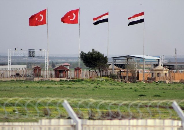 In this photo taken Tuesday, April 10, 2012, the border crossing between Turkey and Syria is seen from a refugee camp near the border, in Kilis , Turkey.