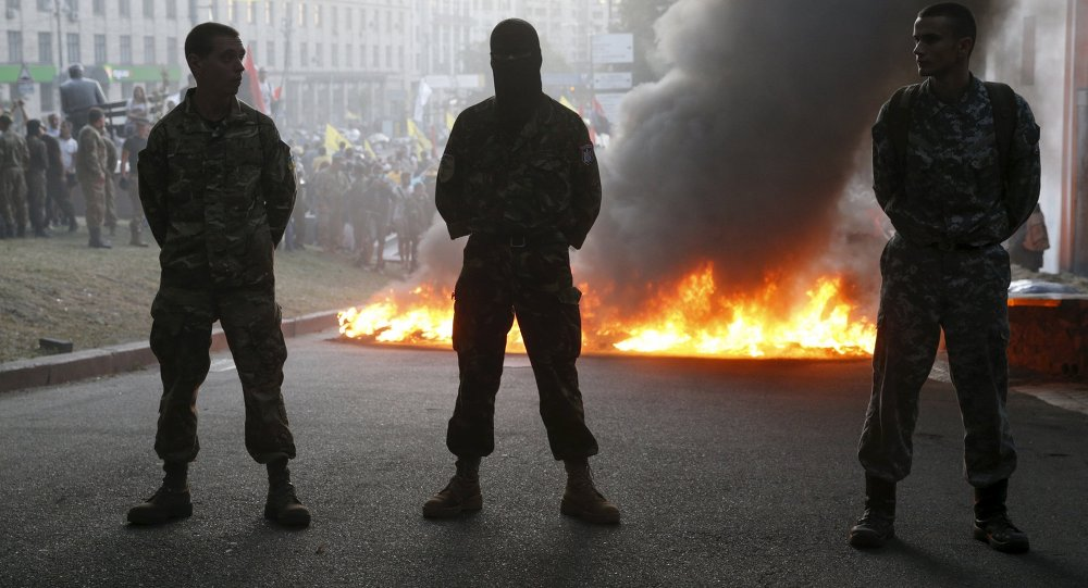 Tyres are set on fire during a rally held by members of the far-right radical group Right Sector, representatives of the Ukrainian volunteer corps and their supporters in central Kiev, Ukraine