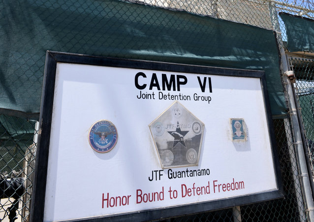 Guantanamo BayIn this April 8, 2014 file photo made during an escorted visit and reviewed by the US military shows the razor wire-topped fence and the watch tower of Camp 6 detention facility at the US Naval Station in Guantanamo Bay, Cuba.
