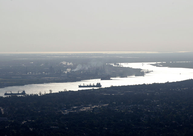 In this aerial photo taken from above New Orleans, ships on the MIssissippi River and refineries in St. Bernard Parish, La.