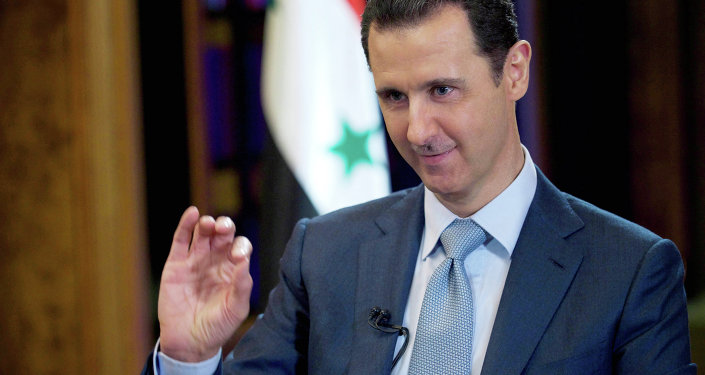 In this Tuesday, Feb. 10, 2015 file photo released by the Syrian official news agency SANA, Syrian President Bashar Assad gestures during an interview with the BBC, in Damascus, Syria