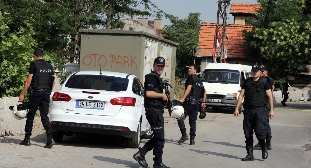 Police officers patrol as Turkish police raide homes in Haci Bayram neighborhood in the capital Ankara, Turkey, Monday, July 27, 2015