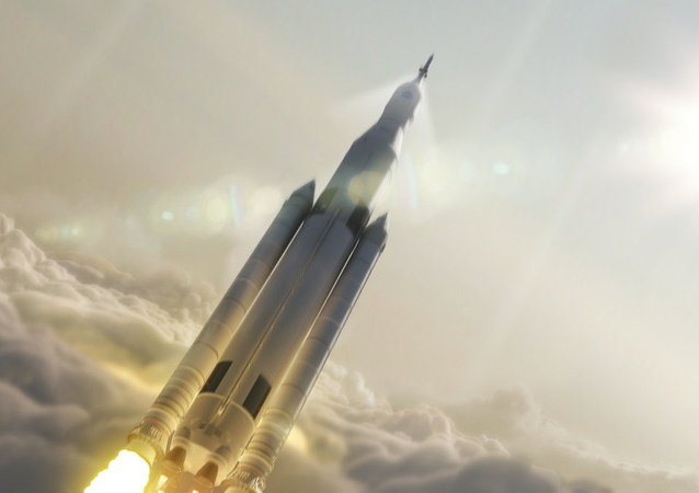 Artist's concept showing the 77-ton configuration of NASA's Space Launch System rocket launching into space.